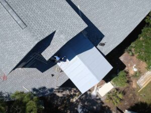 Roof with shingles and metal